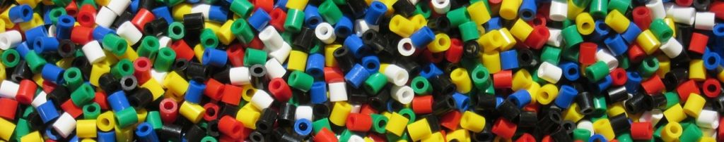 Colorful plastic beads demonstrate color flexibilty with plastic materials